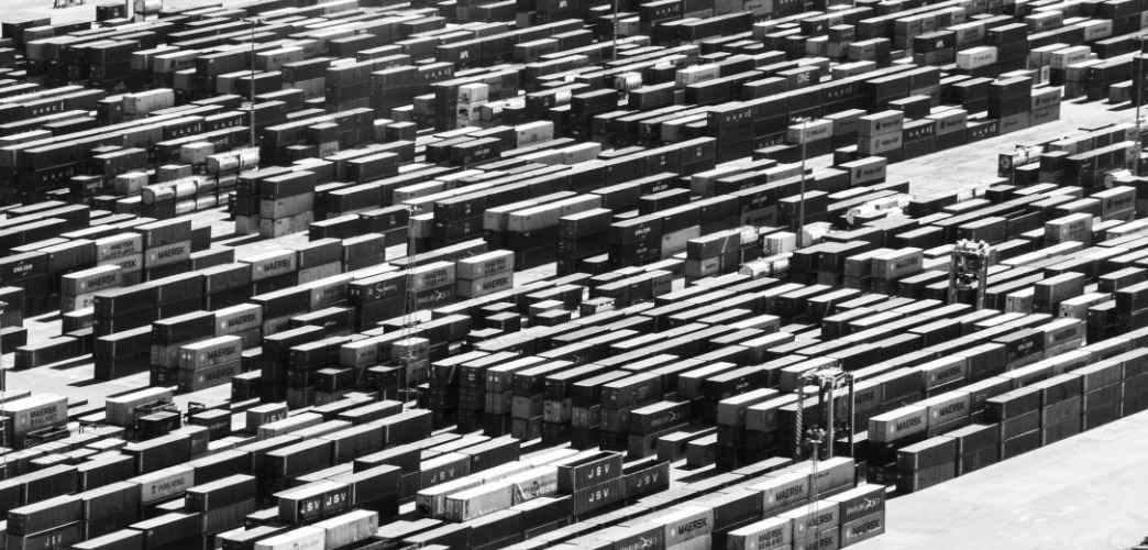 a shipping yard with numerous shipping containers.