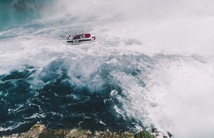 a boat navigating rough waters.