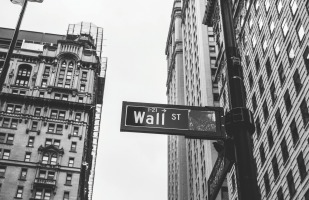 A street sign that says wall street in New York City.