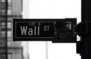 "a street sign that says ""Wall Street"""